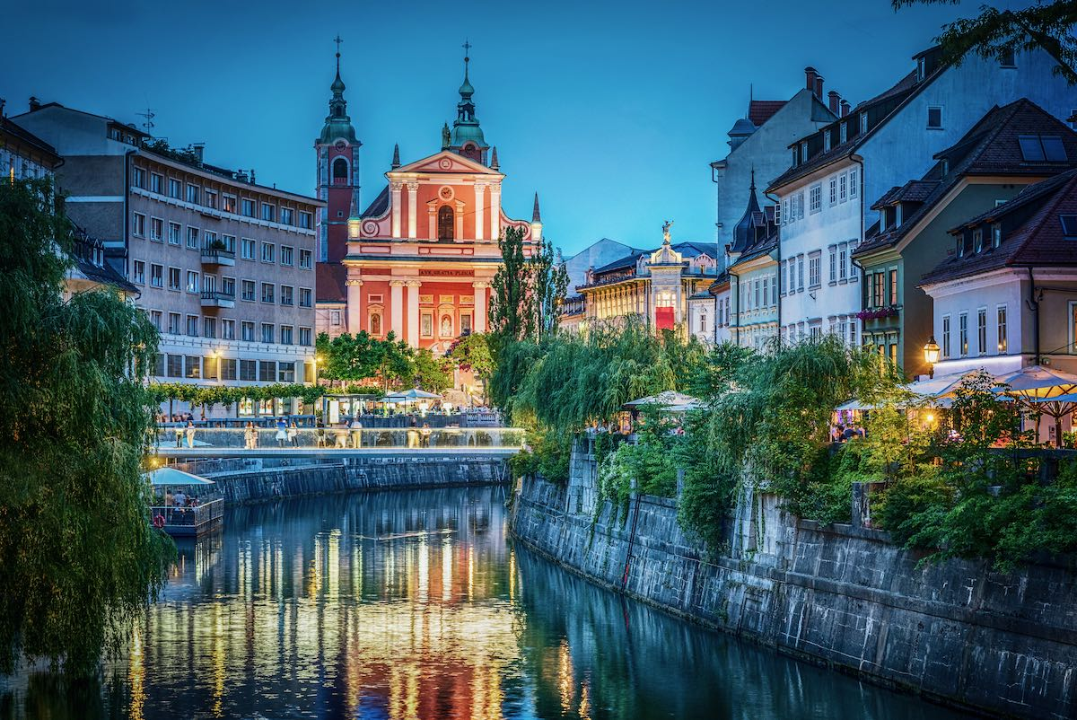 Evening view of the bridge and Ljubljanica river in the city center. Ljubljana, capital of Slovenia.